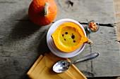 Pumpkin soup in hollowed-out pumpkin