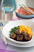 Teriyaki chicken meatballs with mashed sweet potato and baby spinach (Japan)