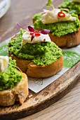 Bruschetta topped with mushy peas and mozzarella
