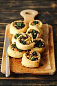 Pastries filled with spinach, ricotta and pine nuts