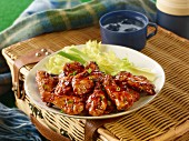 Glazed chicken wings with celery