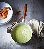 Cream of pea soup with prawns