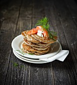 A stack of blinis with smoked salmon