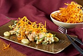 Trout tartare with a honey-mustard sauce and sweet potato straw