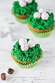 Easter cupcakes with green frosting and sugar eggs