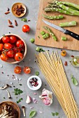 An arrangement of ingredients for pasta dishes with vegetables
