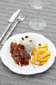 Lamb skewers with rice and mango salad