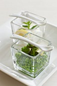 Peas with mint in glass bowls