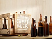 Opened beer bottles and a wooden crate labelled 'Craft Beer'