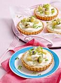 Lemony cheesecake tarts topped with fruits