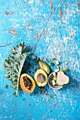 Still life with kale, papaya, avocado and pear