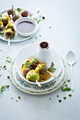 Mango, fig and coconut skewers served with a chocolate and coconut sauce