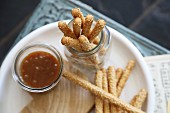 Sesame grissini with a salted caramel dip