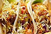 Tacos filled with minced meat, grated cheese, salad and tomatoes in a restaurant in Phoenix, Arizona (USA)