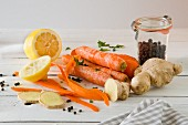 Carrots, ginger, peppercorns and lemons