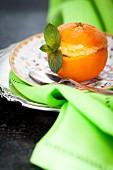 Mandarin sorbet served in hollowed out orange