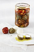 Cream cheese balls with herbs in oil