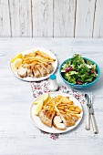 Grilled chicken fillet with chips and a salad
