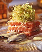 Flash fried salmon and oysters with lemon sauce and spring onion straw