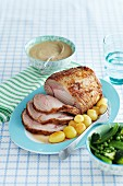 Roast pork with potatoes and green vegetables