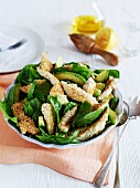 Sesame chicken salad with avocado and spinach