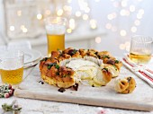 A bread wreath with baked Camembert for Christmas