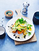 Grilled bread topped with avocado, egg and yoghurt sauce