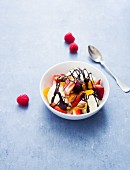 Vanilla ice cream with berries and chocolate sauce