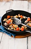 Fried aubergines and tomatoes with Panko flour, pine nuts and raisins