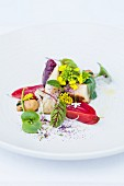 Chioggia beets, crapaudine beets and celeriac with edible flowers
