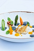 Plaice fillet with scallops, carrot cream and black garlic butter