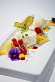 Lychee mousse with roasted mango ice cream and tropical fruit