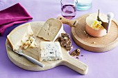 A cheese platter with drinks and fruit bread