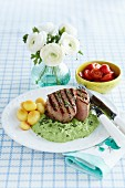Grilled veal medallions in herb sauce with potatoes