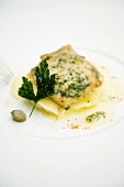 Fried thornback ray with mashed potatoes and parsley and caper butter