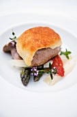 Saddle of lamb in a Parmesan crust, fresh wild mushrooms and Provençal vegetables