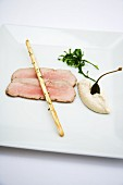 Pink vitello tonnato with grissini