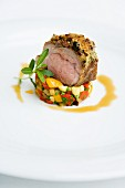 Saddle of lamb with a thyme and olive crust on vegetable tartare
