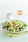 Potato and cheese salad with pears and herbs