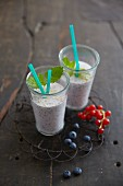 Berry smoothies with blueberries and redcurrants
