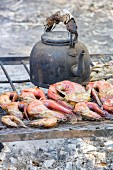 Fresh fish and a kettle on a barbecue, Zambia, Africa