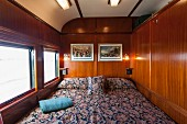 A bed in a suite in the luxury train Rovos Rail (journey from Durban to Pretoria, South Africa)