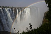 A rainbow over the Victoria Falls, Zambia and Zimbabwe, Africa