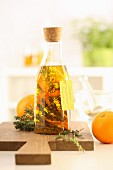 Homemade herb oil with thyme and oranges