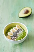 A smoothie bowl with avocado, spinach and banana