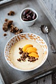 A smoothie bowl with dates, gingerbread and mandarines