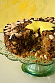 Fruit cake with nuts and marzipan, sliced