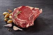 Raw beef ribs, garlic and potatoes