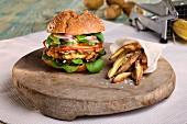 A veggie burger with potato wedges