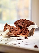 A broken chocolate muffin